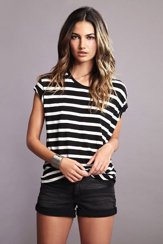 ac3bf1d5acf Le Fashion Blog Model Lily Aldridge for Velvet by Graham Spencer Collection Lookbook  Black And White Dani Striped Tee Black Denim Shorts Wav.