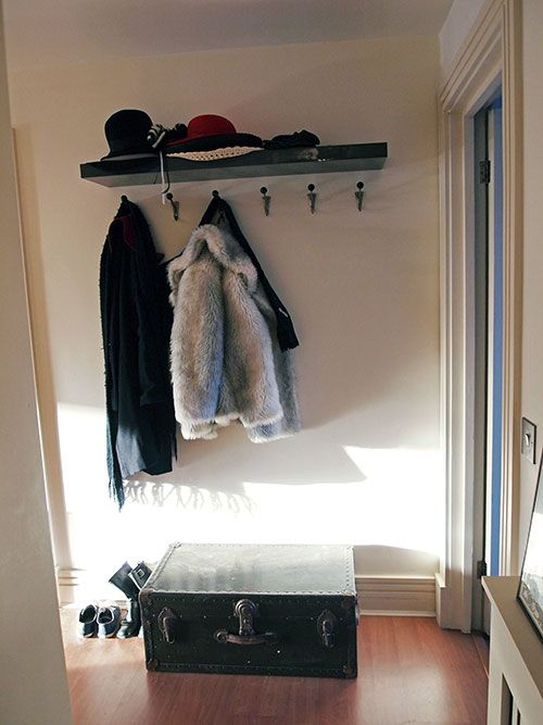 My hallway... with Ikea Lack shelf (acting as a hat rack), vintage coat hooks, and vintage trunk.