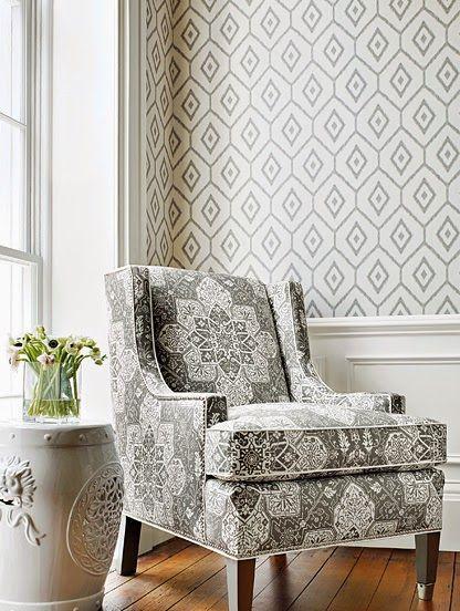 cozy gray living room. chair rail up wallpaper. geometric gray and