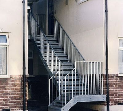 exterior quarter-turn staircase (metal frame and steps) Crescent Stairs