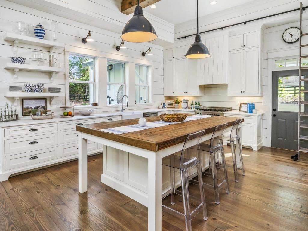 White Farmhouse Kitchen With Wood Island White Farmhouse Kitchens Wood Floor Kitchen Farmhouse Style Kitchen