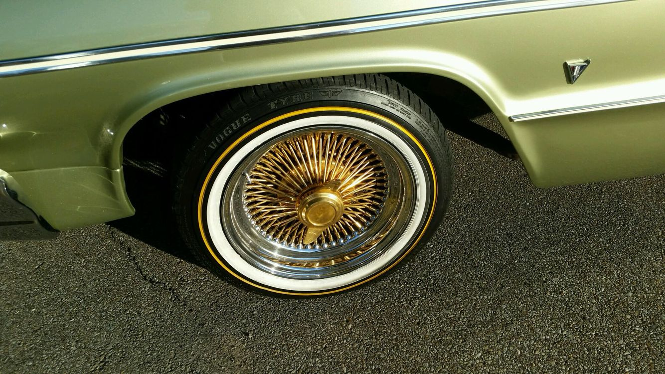 64 with green pain white wall tires and gold 100 spokes rims