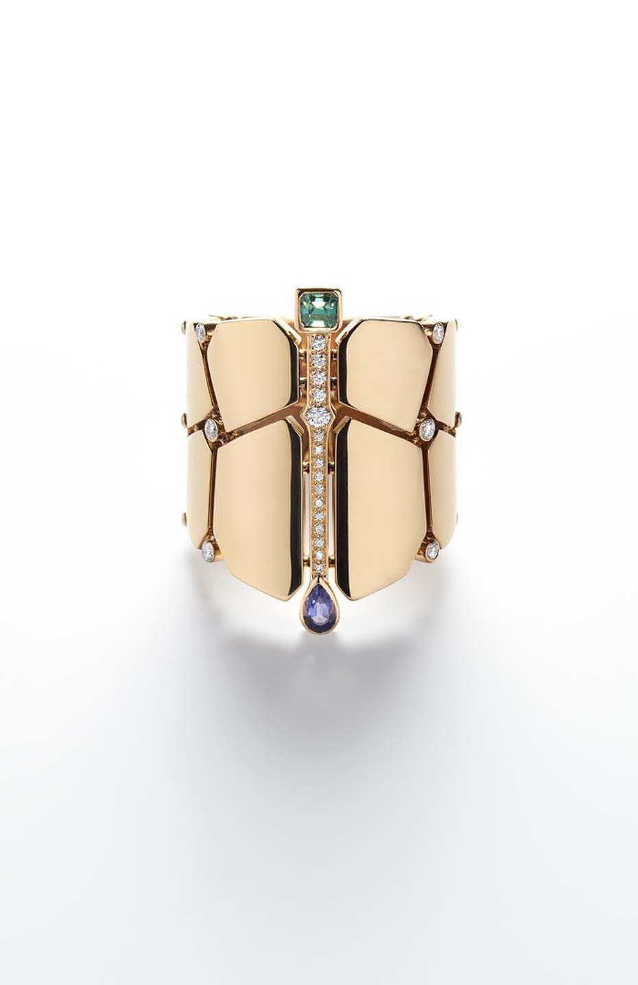 Hermès Niloticus rose gold cuff featuring a series of coloured stones including a pear-shaped iolite and a baguette-shaped beryl as well as brilliant-cut diamonds.