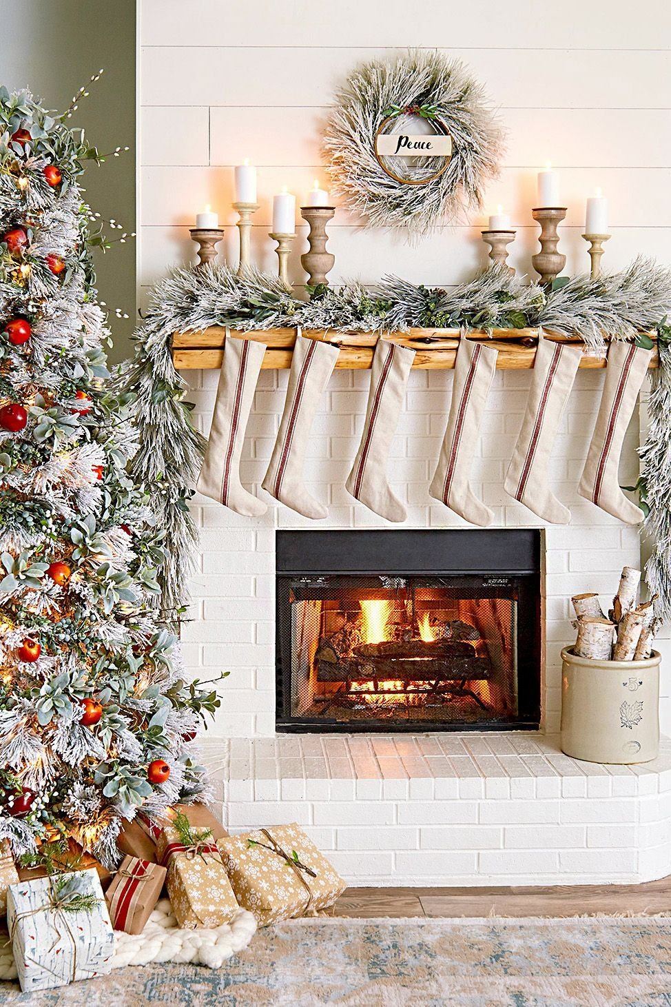 These Christmas decorating ideas will have your living room overflowing with cheer, whatever your decorating style. From mantel decorations, and Christmas tree ideas, to ways to incorporate your own home style into your Christmas décor theme, this gallery has plenty of Christmas decoration inspiration. #christmasdecorideasforlivingroom #christmasdecorations #holidaydecor #holidayideas #christmastree #bhg