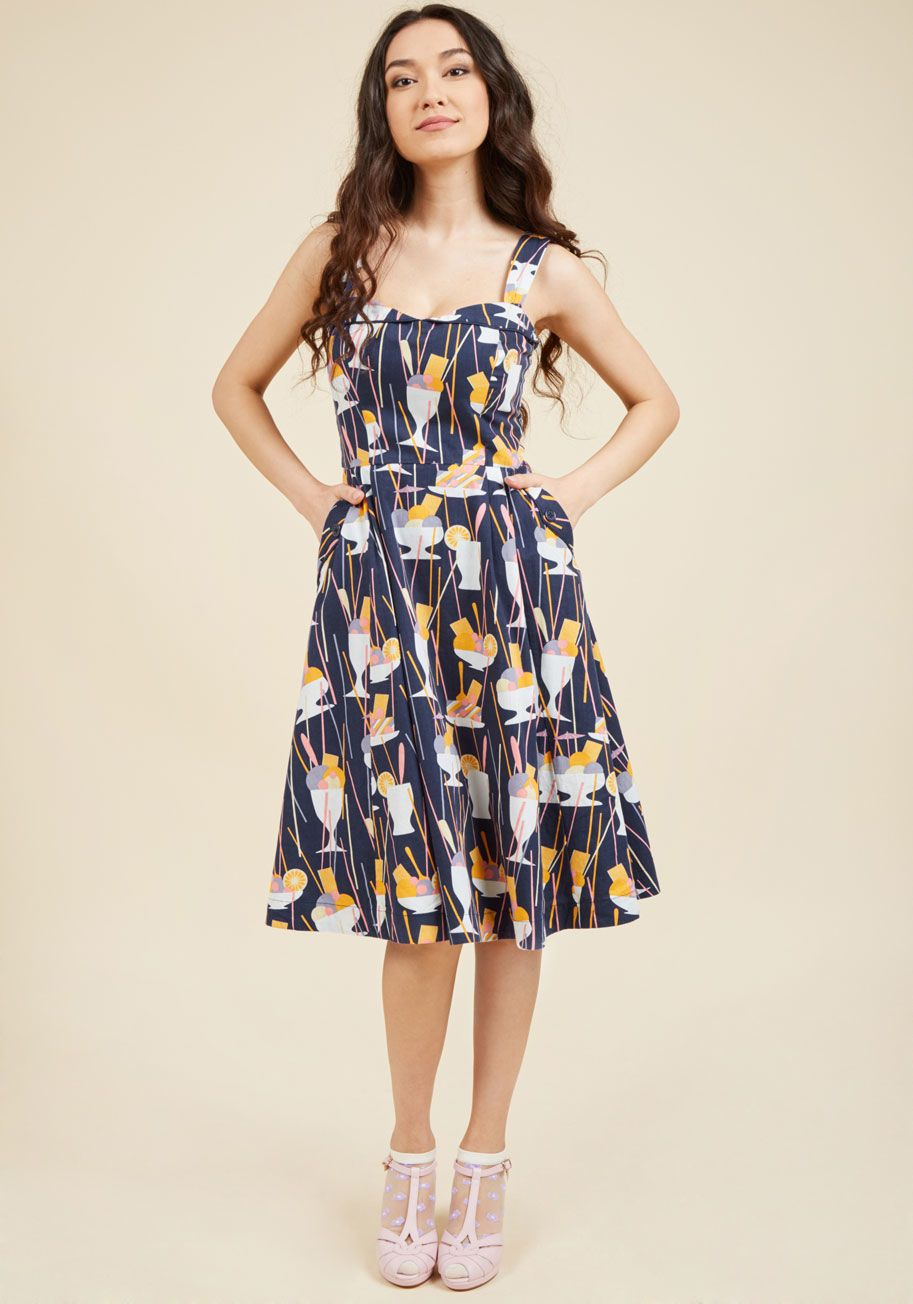 <p>A vintage-inspired ensemble shouldn't take eons to create! This navy blue dress by hard-to-find British brand Emily and Fin completely agrees, which is why its foldover collar, deep pockets, and delectably dandy print of orange, lilac, and vanilla desserts were designed to toss on and impress instantly.</p>