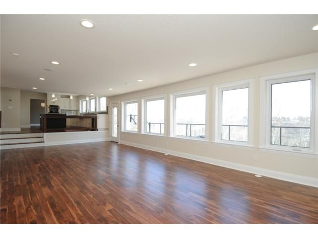laminate flooring sunken living room best light grey paint color for wood floors on both levels with white the side of step so it is easily visible