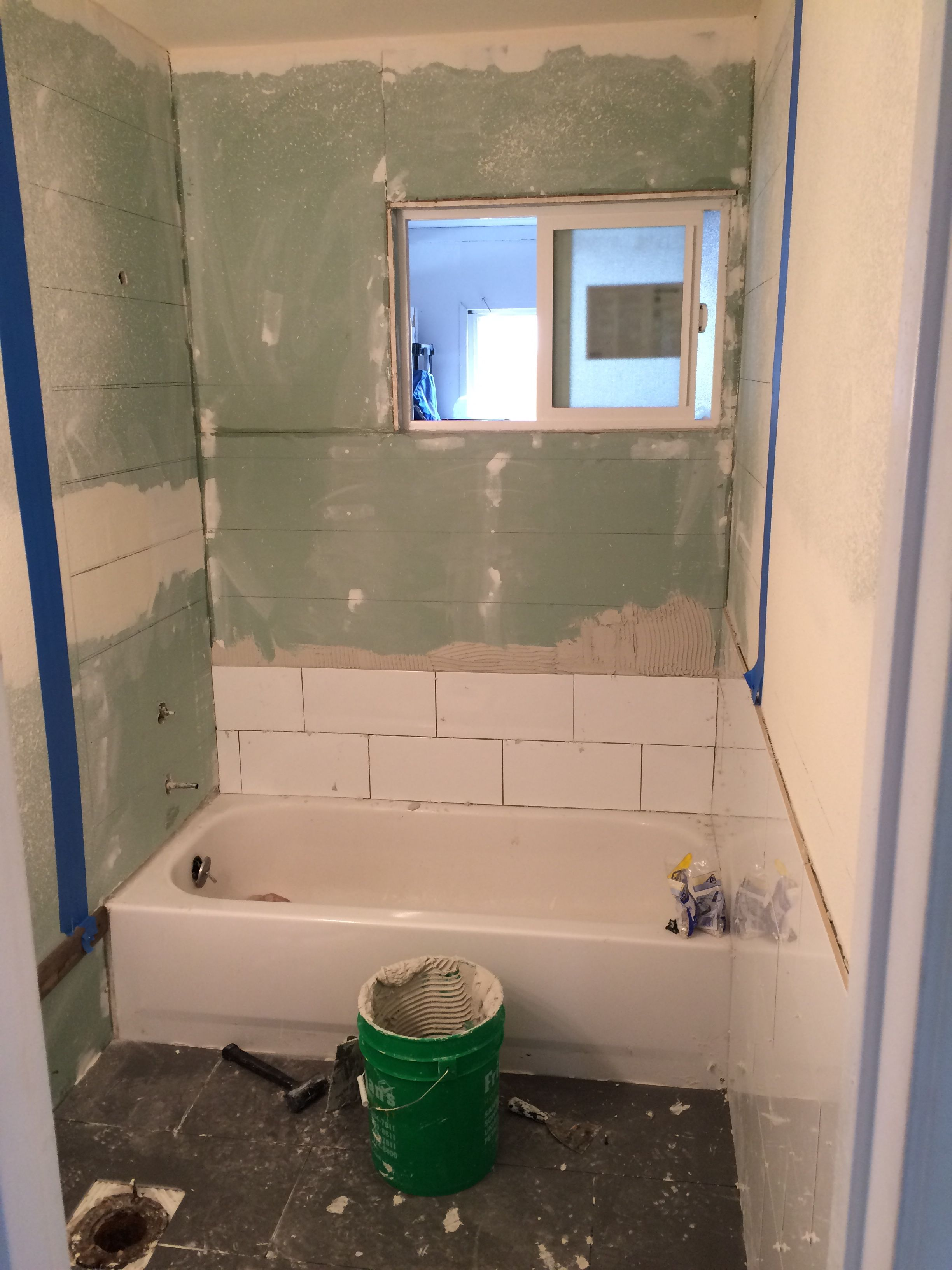 laying wall tile 8x16 White subway tiles by \'BLOC\' 12x24 grey floor ...