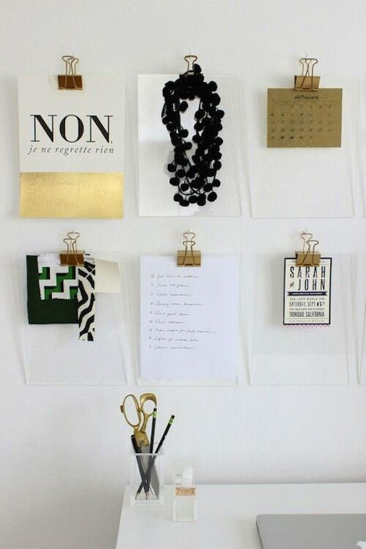Use gold binder clips to hang papers and notes. Seems easy enough to DIY  with bronze spray paint.