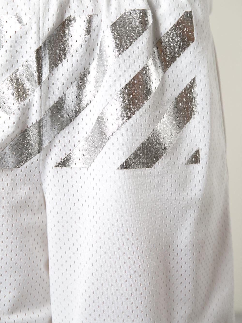 59de6a3e99c2 Off-white Metallic Stripe Perforated Track Shorts - Patron Of The New -  Farfetch.com