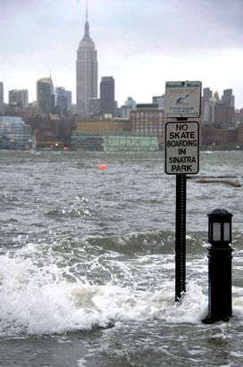 The Hudson River swells and rises over the banks of the Hoboken, N.J. waterfront as Hurricane Sandy approaches, Oct. 29, 2012. (Charles Sykes/AP Photo )