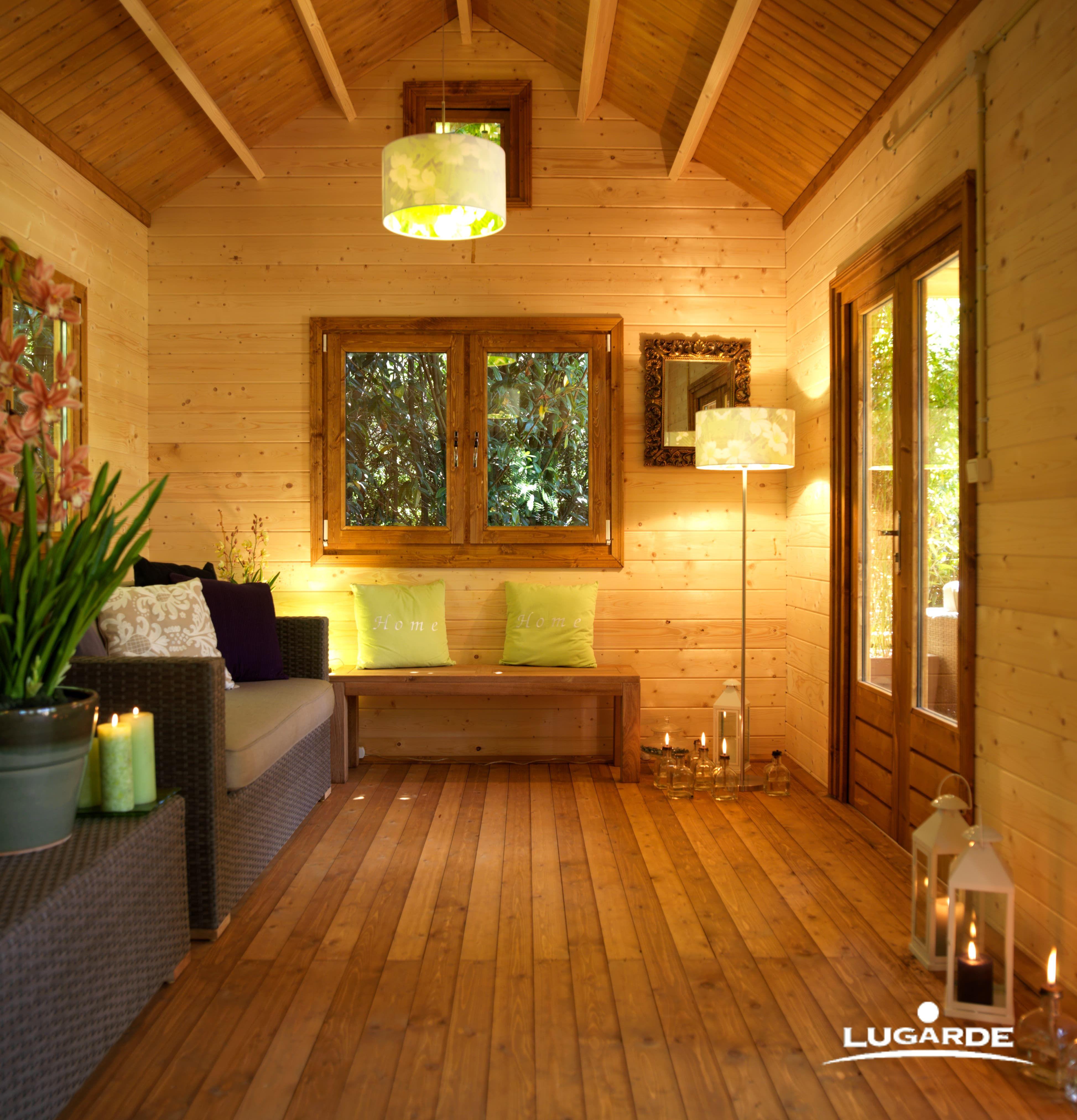 die nat rliche farbe des holzes und gr ne akzente die sich innen und beim blick in den garten. Black Bedroom Furniture Sets. Home Design Ideas