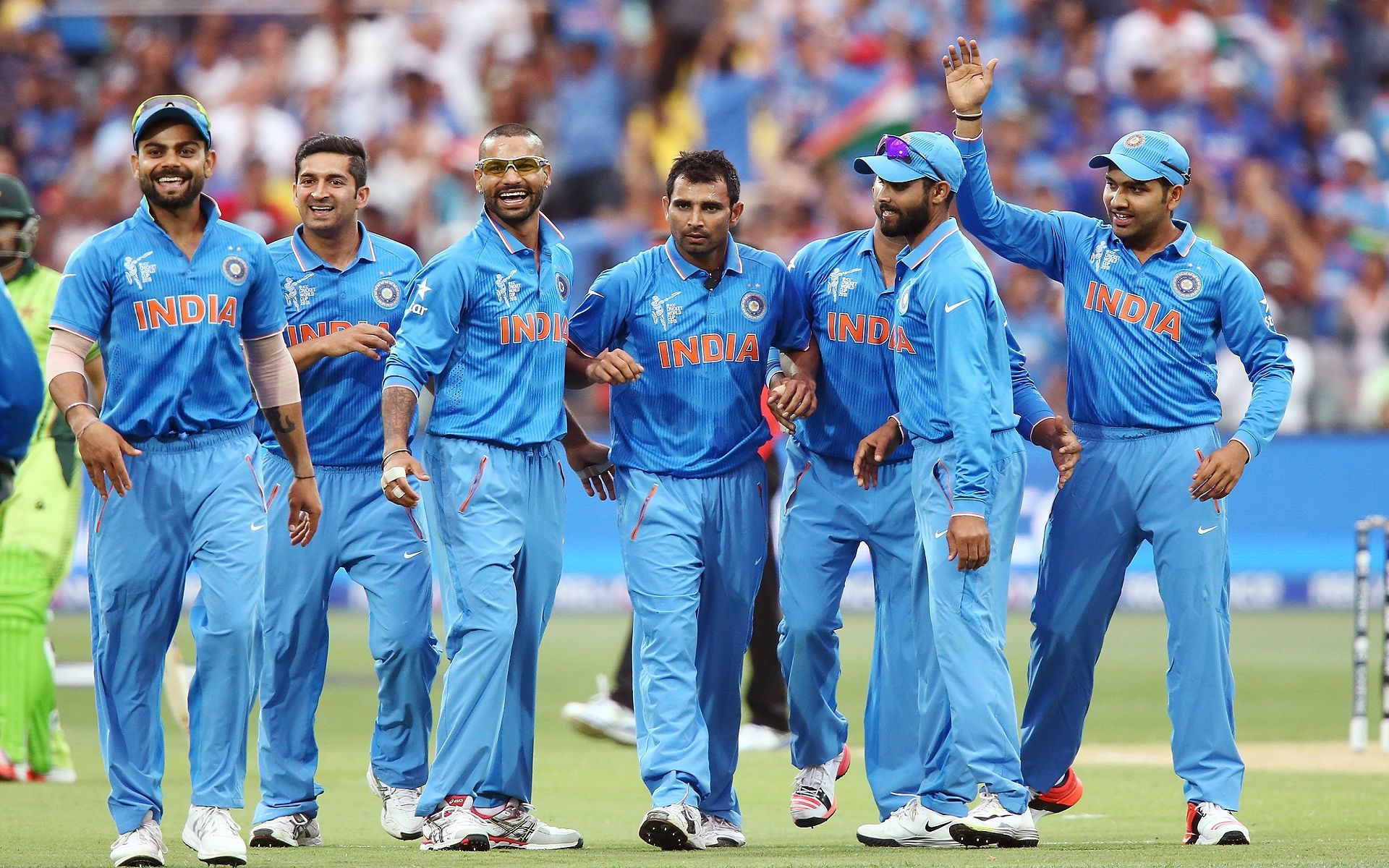 Happy indian cricket team on the ground nice wallpapers