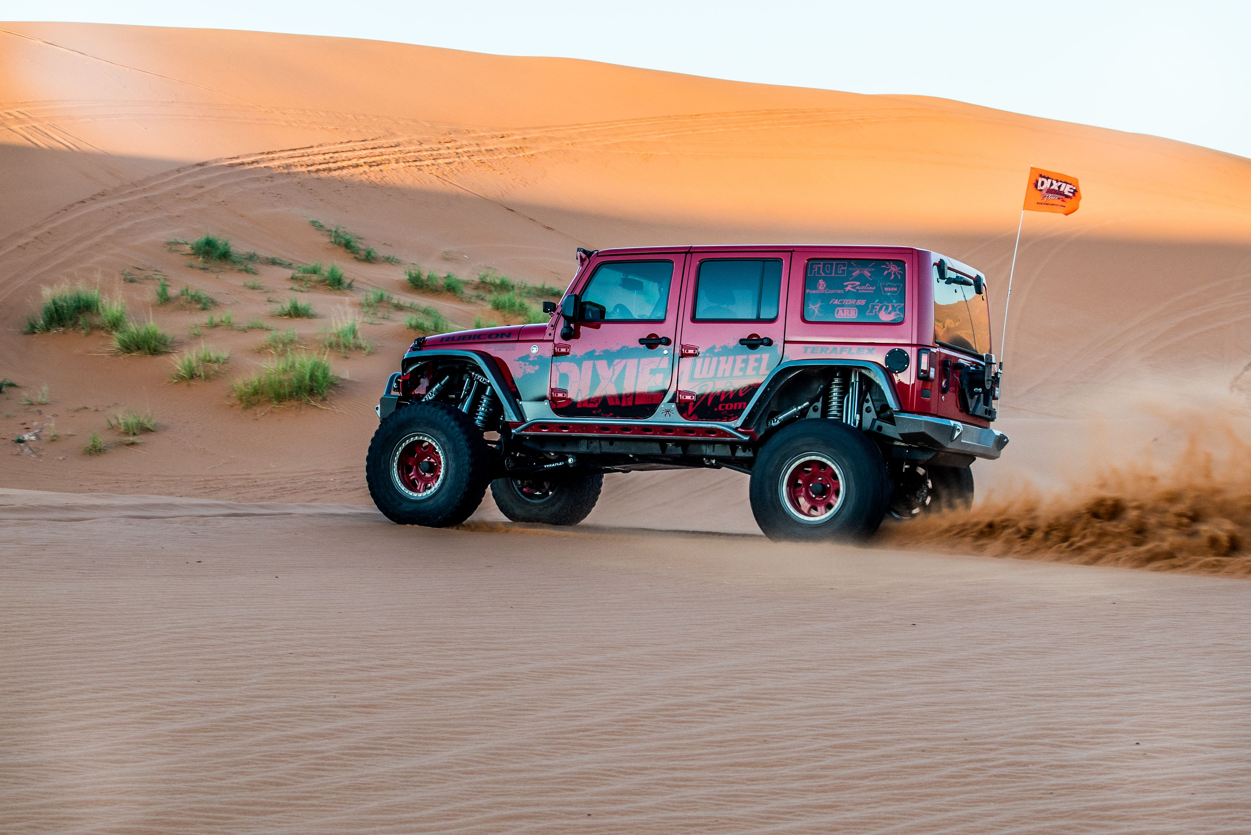 Dixie 4 wheel drive jeep running the dunes at sandhollow state park in st george