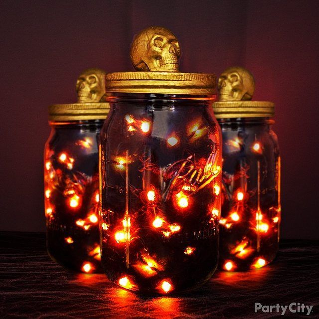 When #FrightNight falls, light the way with this easy #DIY. Create your own #Halloween in a jar by using products from #PartyCity! Simply fill a #masonjar with #spooky gauze and orange lights; then, top it off with a painted lid and skull decal! #Celebrate #TrickOrTreat
