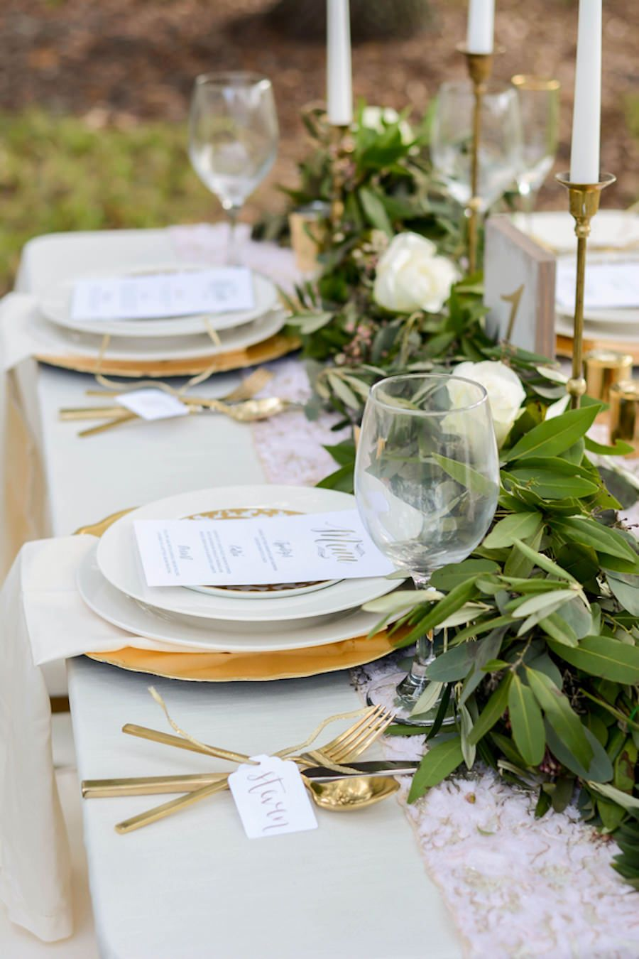 Wedding reception tablescape with lush greenery table