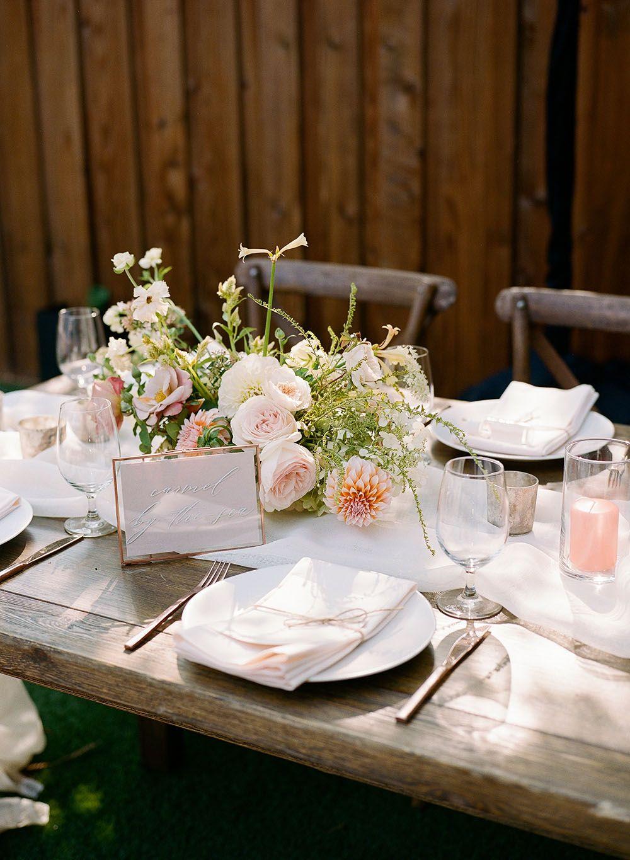 Cozy backyard wedding with pastel dahlias and craft