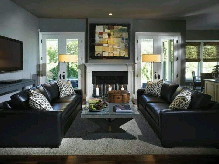 Dark gray living room black leather sofa with gray walls for Black and grey couch