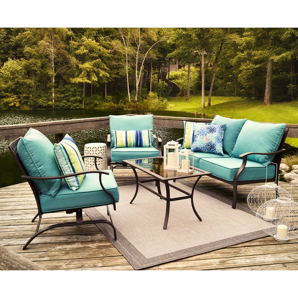 the cold with the bright blue of this patio set