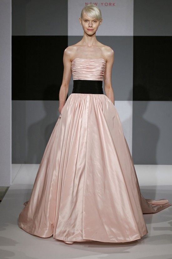 A barely there pink becomes modern and chic with a black cummerbund, allowing you to create a soft statement with a sophisticated edge with this Isaac Mizrahi for Kleinfeld gown. #pink #wedding #gown @isaacmizrahi