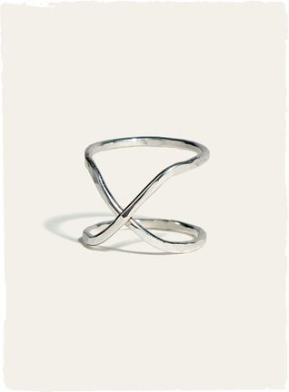 A sleek, modern and everyday wearable accessory, the hand-hammered sterling silver crisscross ring.