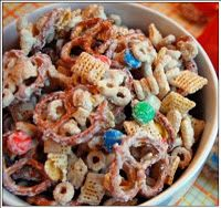 Festive Reindeer Mix:  3 cups of Rice Chex  3 cups of Corn Chex  3 cups of Cheerios  3 cups of stick pretzels  2 cups of peanuts  16 oz bag of M & M's  (3) 12oz packages of white chocolate chips    Mix all ingredients, except for the white chocolate chips. Melt those in the microwave, one bag at a time, until soft. Pour melted chocolate over the mixture and work together. Lay snack mix out on a wax paper to set. Once it's hard, break up into chunks.