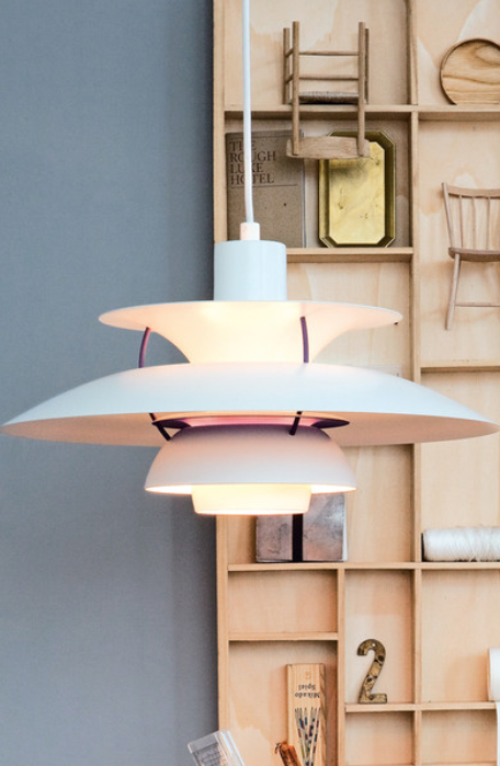 The classic PH 5 is one of Louis Poulsen's most famous designs and was developed by Poul Henningsen in 1958 in response to constant changes to the shape and size of bulbs by bulb manufacturers.