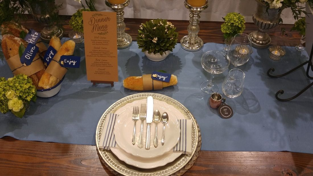 Approachable elegance table setting featured in Seattle Wedding Show by Nola's Events.  Farm table with mixed matched vintage flatware.