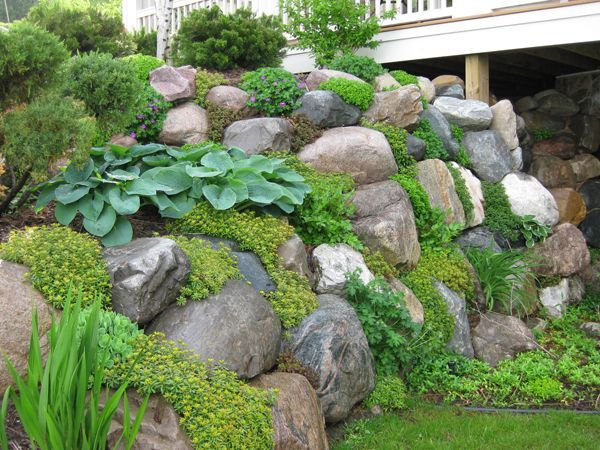 Natural Look Retaining Wall Rock Wall Gardens Sloped Garden Rock Garden Landscaping