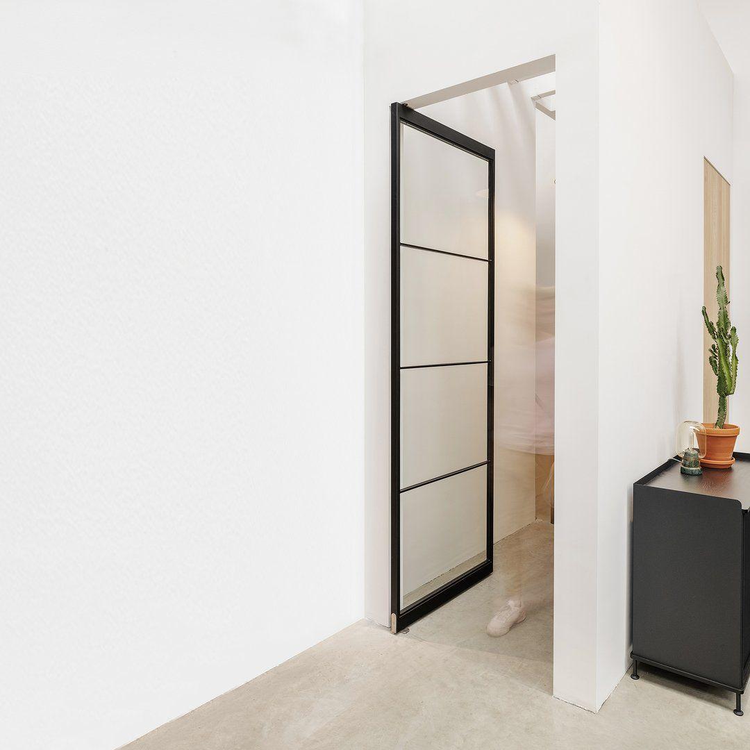 These beautiful frameless steel pivot doors are custom…