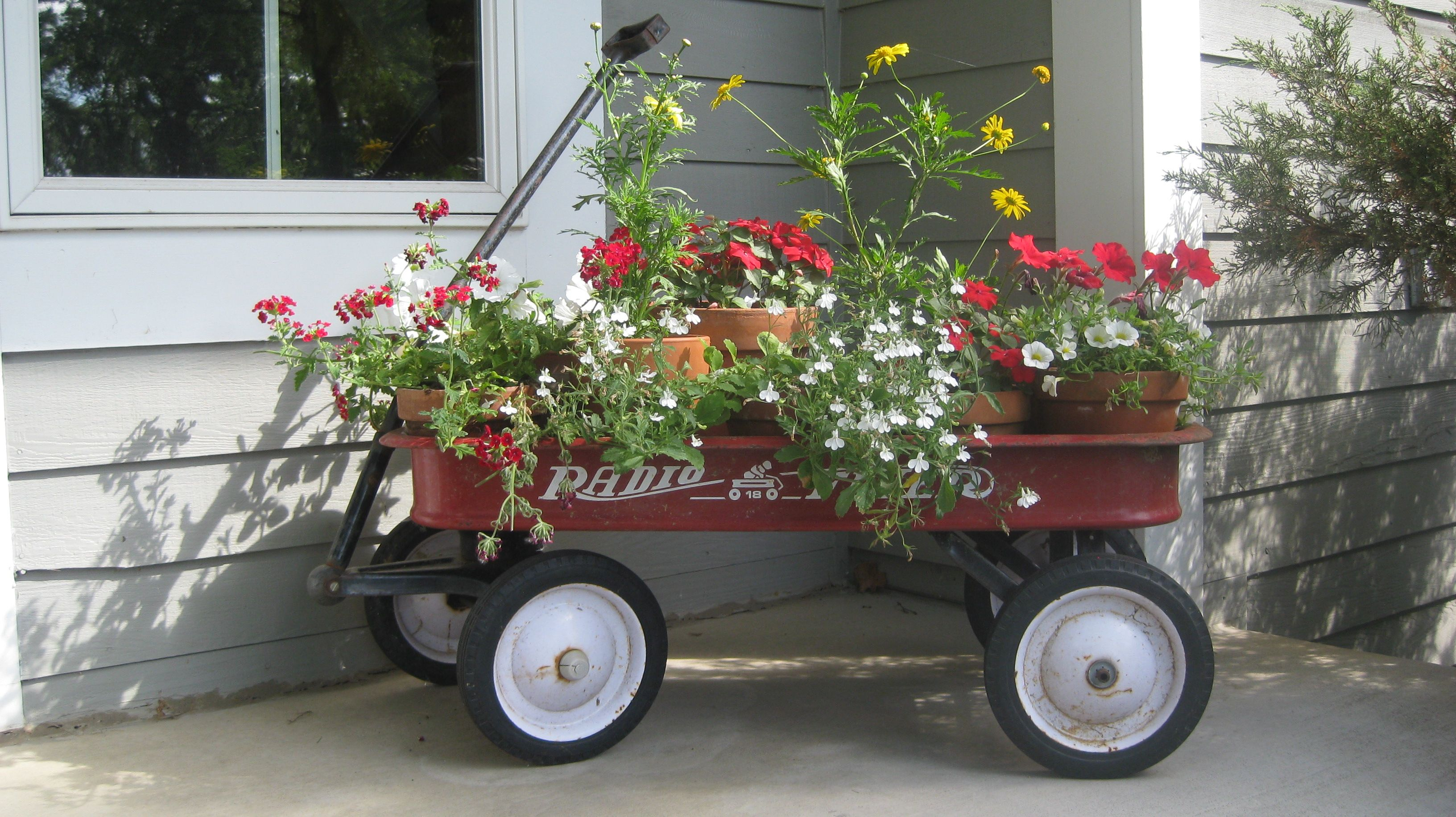 Stedman Version Of The Little Red Wagon As A Planter Wagon Planter Red Wagon Garden Wagon