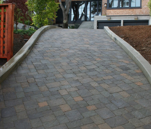 Sloping driveway stunning sloping carriage stone for Sloped driveway options
