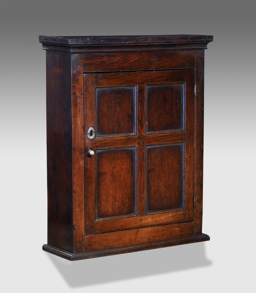 Eighteenth century oak wall hanging cupboard moulded cornice over a