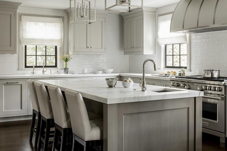 Light Gray Oak Center Island With White And Gray Marble Is