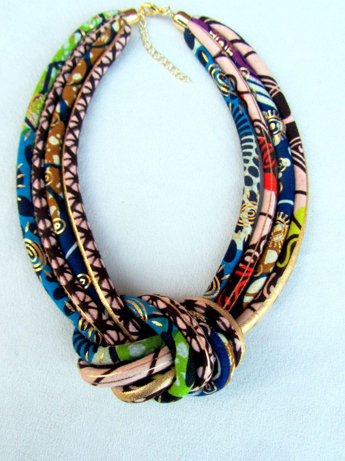 African Fashion fabric bib necklace, african wax golden metalic print with a central knot . #africanfashion