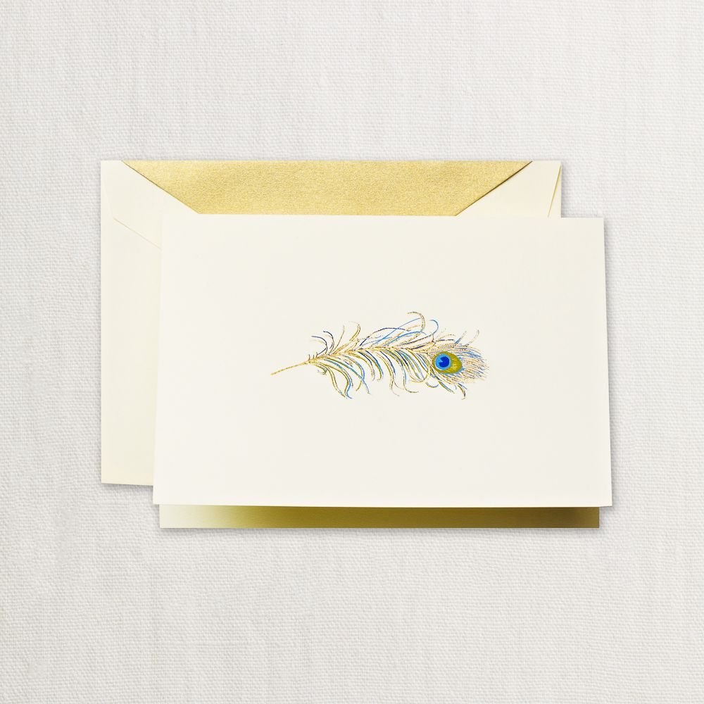 Hand Engraved Peacock Feather Note: A little exotic and entirely luxurious, this hand engraved note features a shimmering peacock feather rendered in blues, golds, and green. A matching ecruwhite envelope is lined in gold.