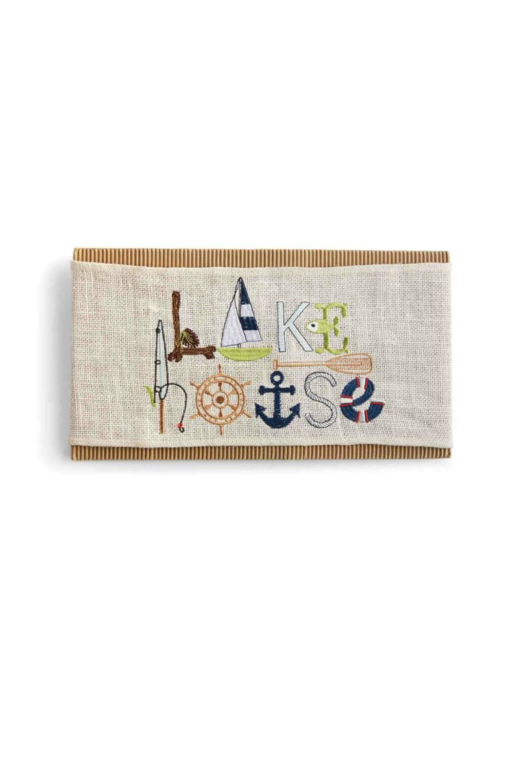 """Bleached burlap pillow wrap features embroidered """"Lake House"""" word art."""