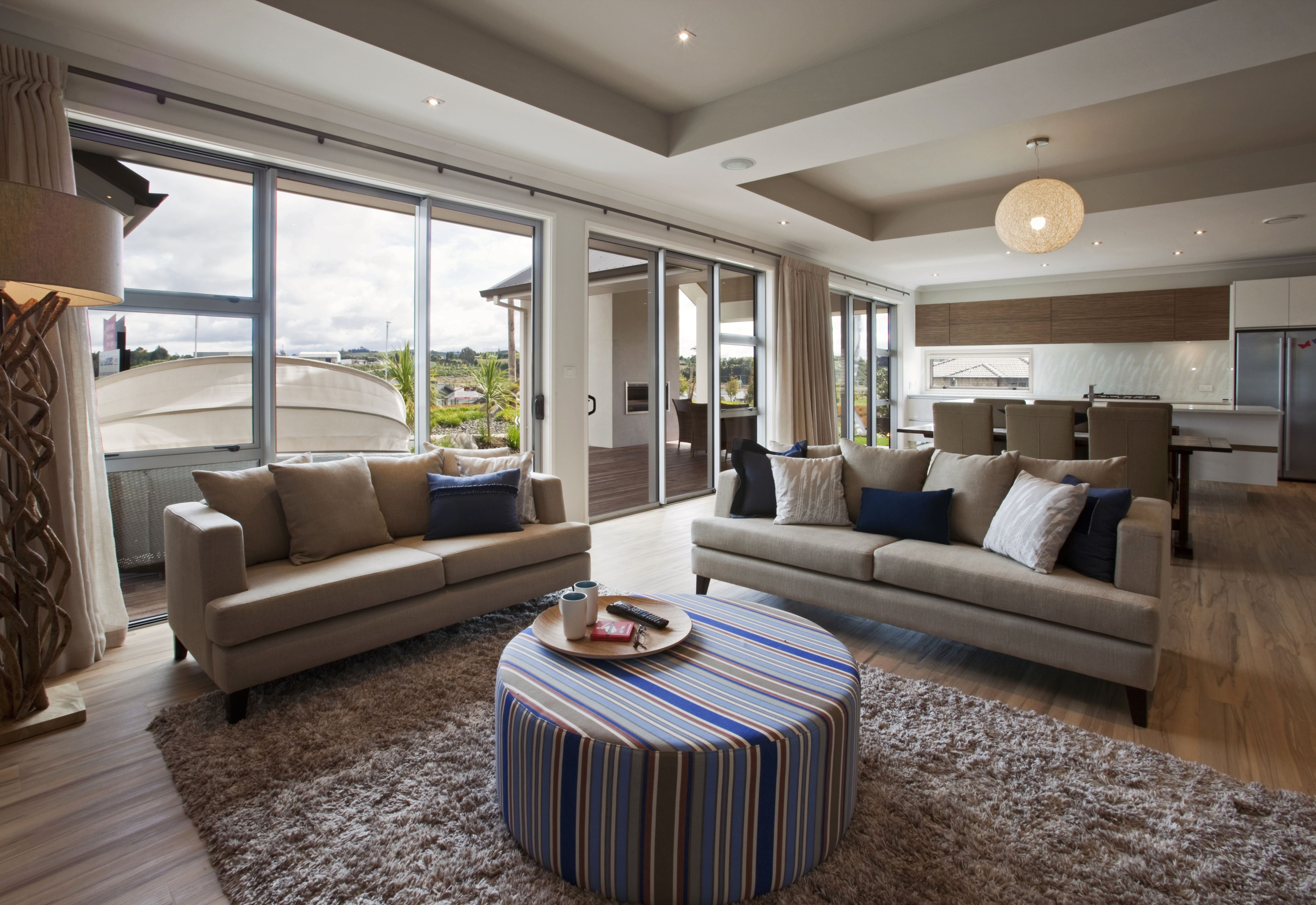 Indoor outdoor flow. With raised inset ceilings giving an