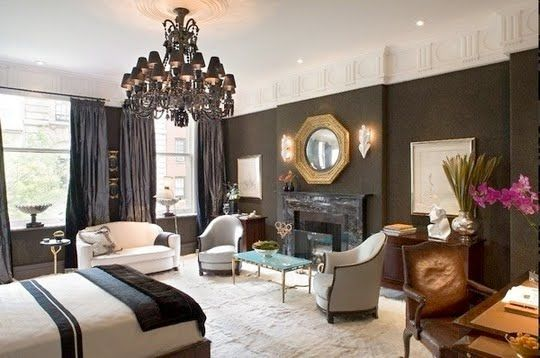 "Larry Laslo's dazzling master bedroom ""What is Black, White and ... Suite?"" prominently features a Phillipe Starck zenith black Baccarat chandelier with over 250 crystals."
