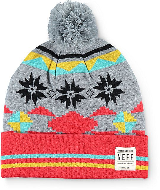 73d4eb36ccd Accent any outfit with the styling of this cuffed beanie that features a  mixed stripe and tribal print finished with a solid grey pom at the top.