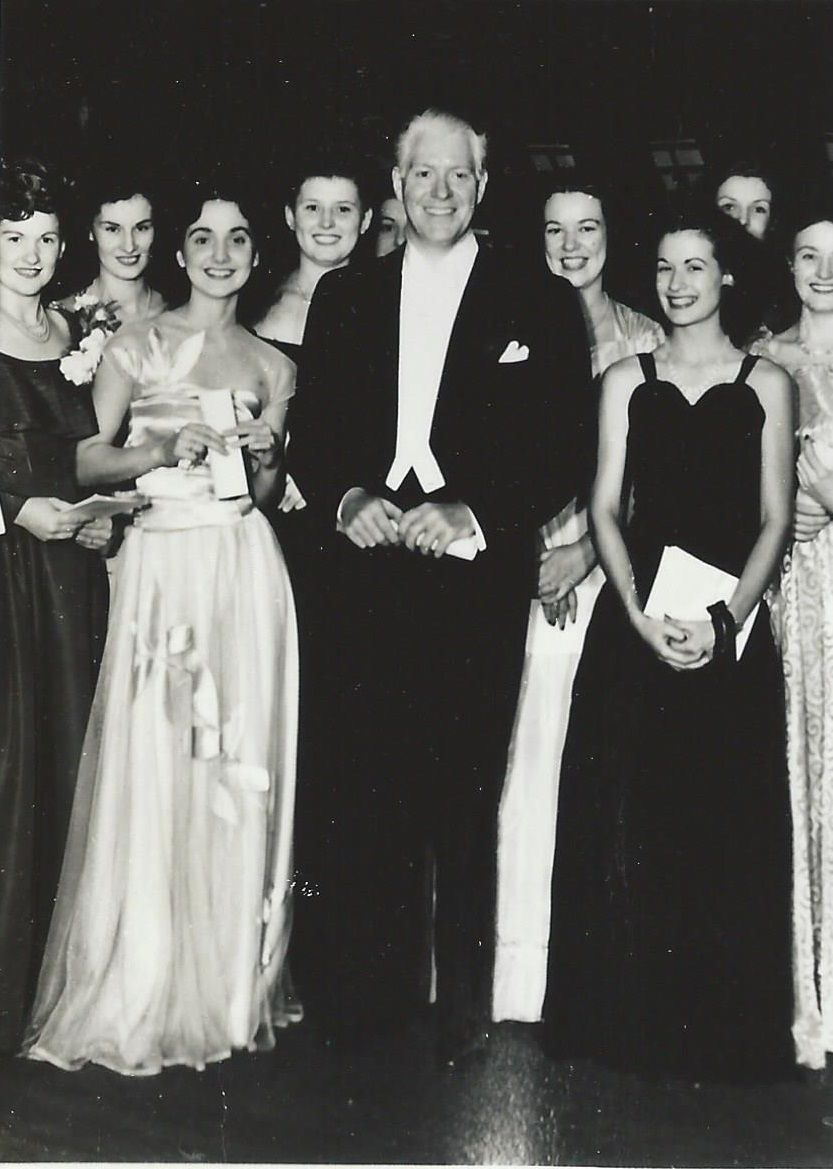 From an original negative: Nelson with some well dressed fans.- ESCANO COLLECTION
