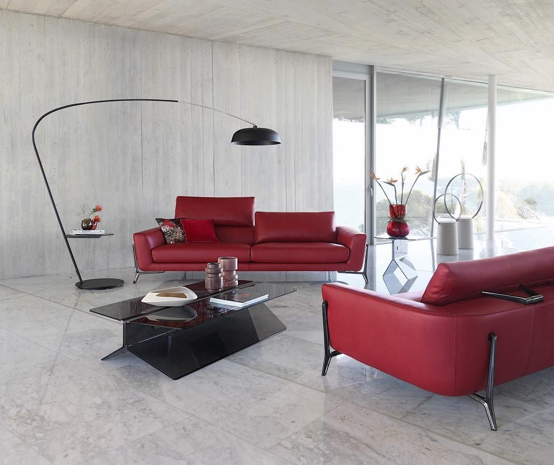 ROCHE BOBOIS Covered in red leather and with slender cast