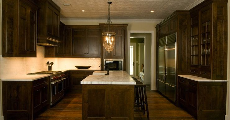 Tin Ceilings With Maple Cabinets In Kitchen