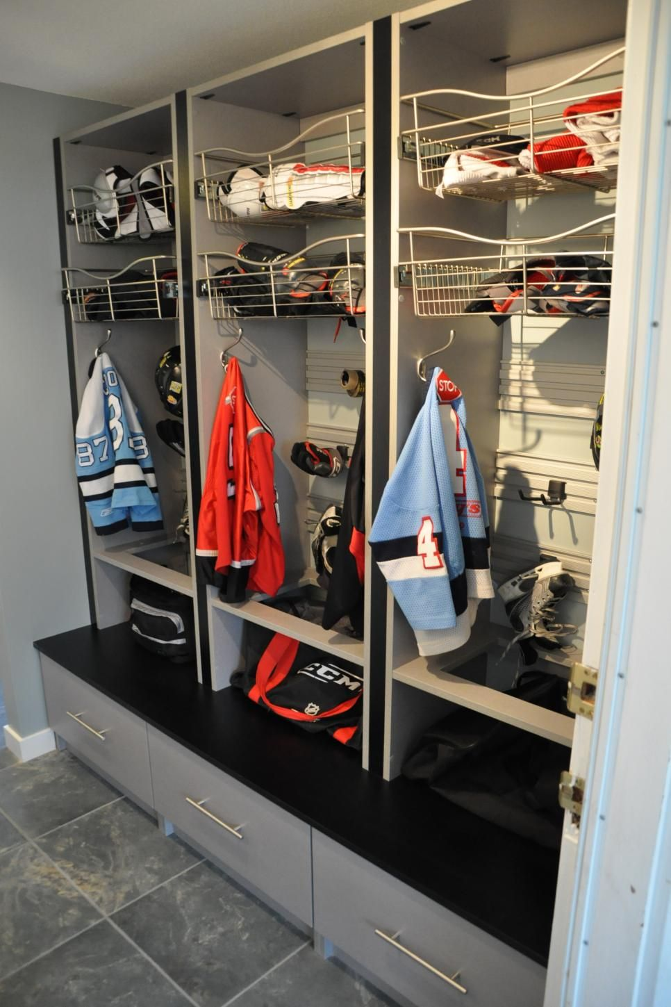 Storage Closet After The Was Removed And Custom Built Lockers Were Installed To Keep Kids Sports Gear Organized