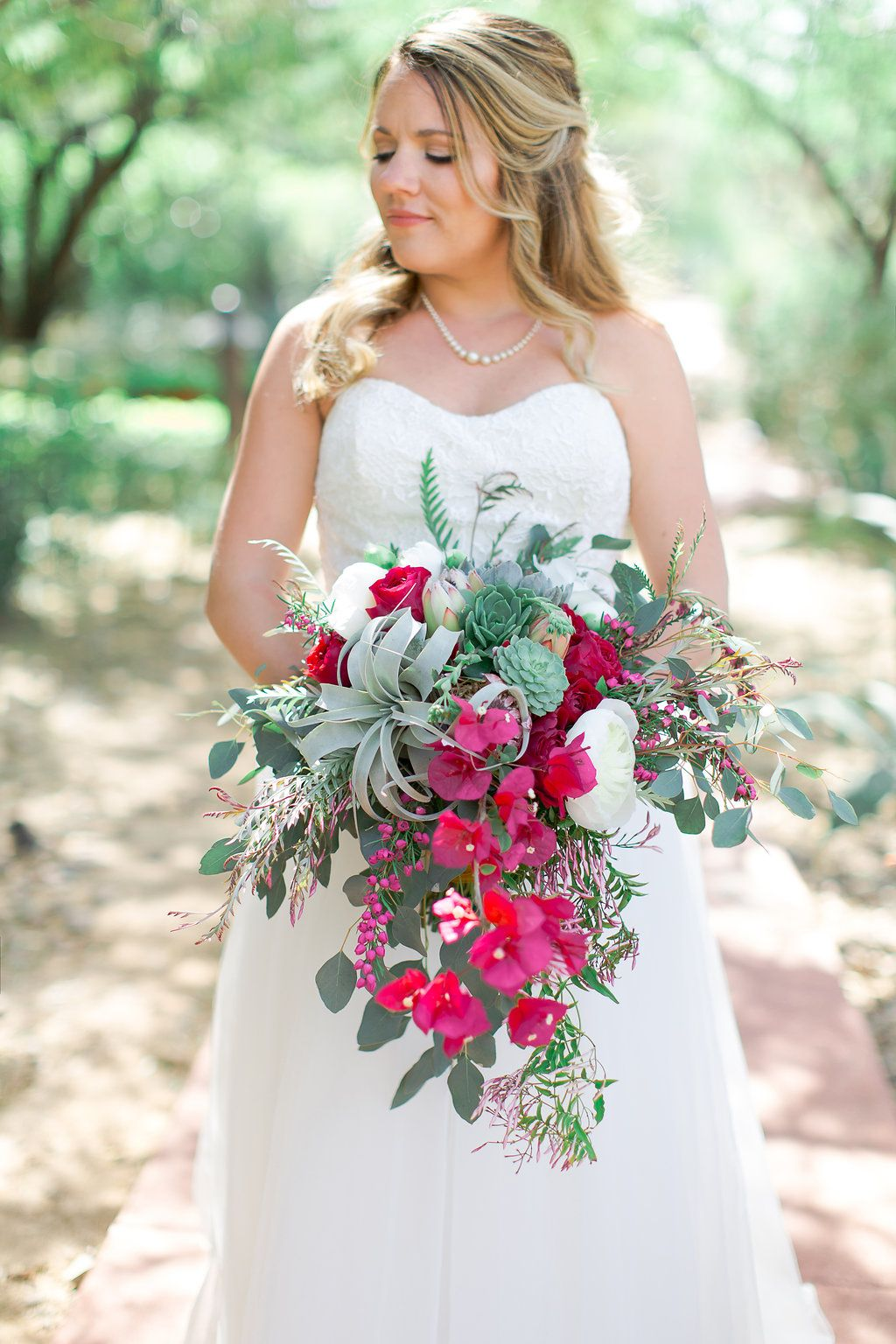 Large cascade desertinspired bouquet featuring peonies