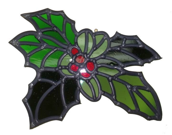 Hand made stained glass holly leaves.  £50.00 plus postage