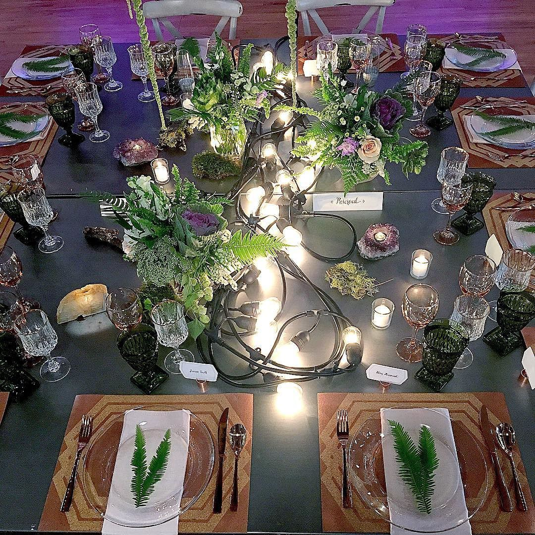 Steel tabletop with industrial lighting cords as a table runner. It's fun to use lighting in unexpected ways.  #tablerunner #weddingideas #tablescapes #eventstyling #events @better2gather #braxtontable #corkplacemats #ferns #montanawedding #billingswedding @izatchu @historicbillingsdepot @macsfloral @hutcheventsmt