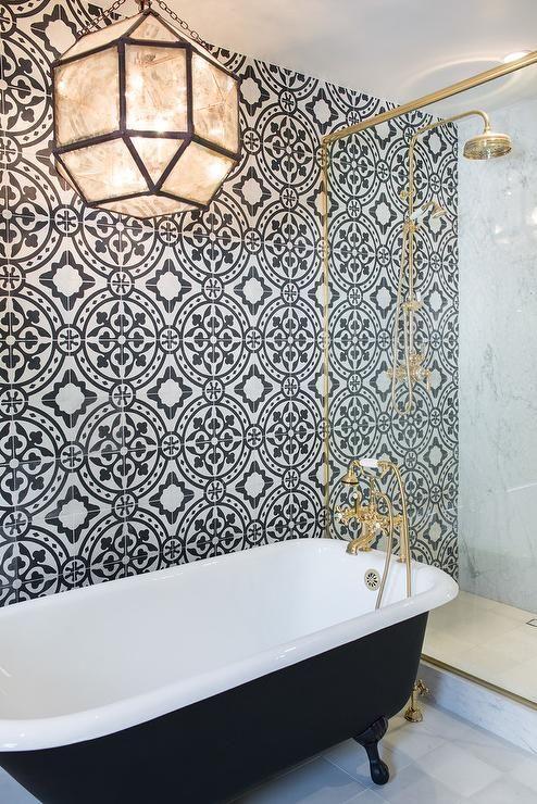 Black Claw Foot Tub Next To Glass And Brass Shower Enclosure Contemporary Bathroom Bathroom Interior Bathroom Design Bathrooms Remodel