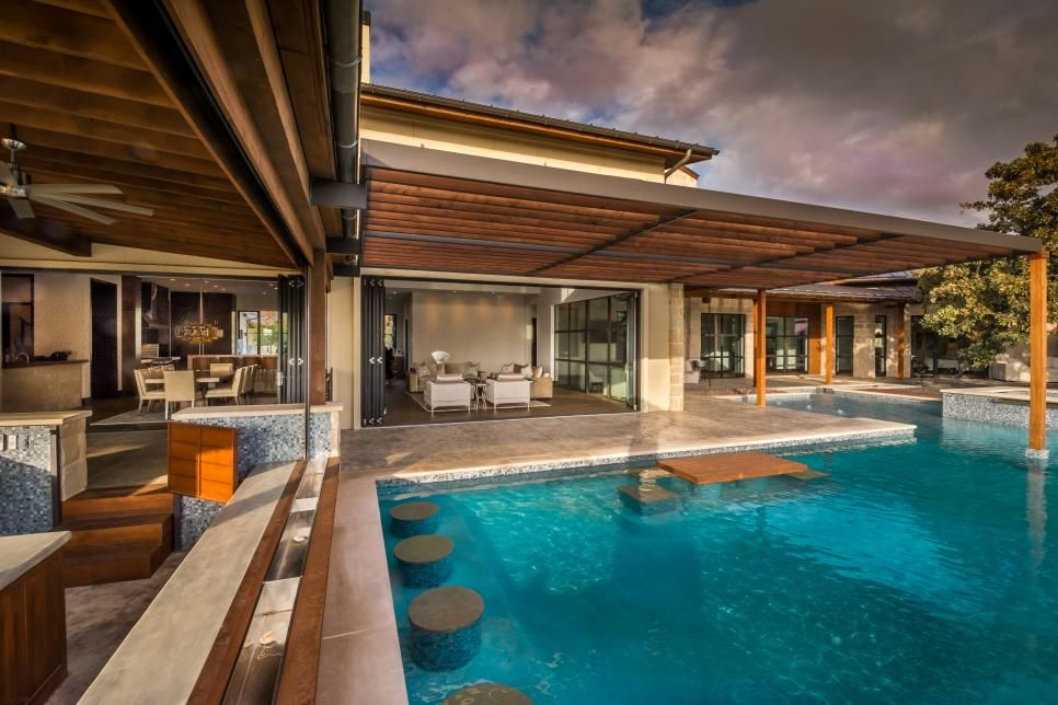 This outdoor oasis is complete with a dining, living and ... on Complete Outdoor Living id=93697