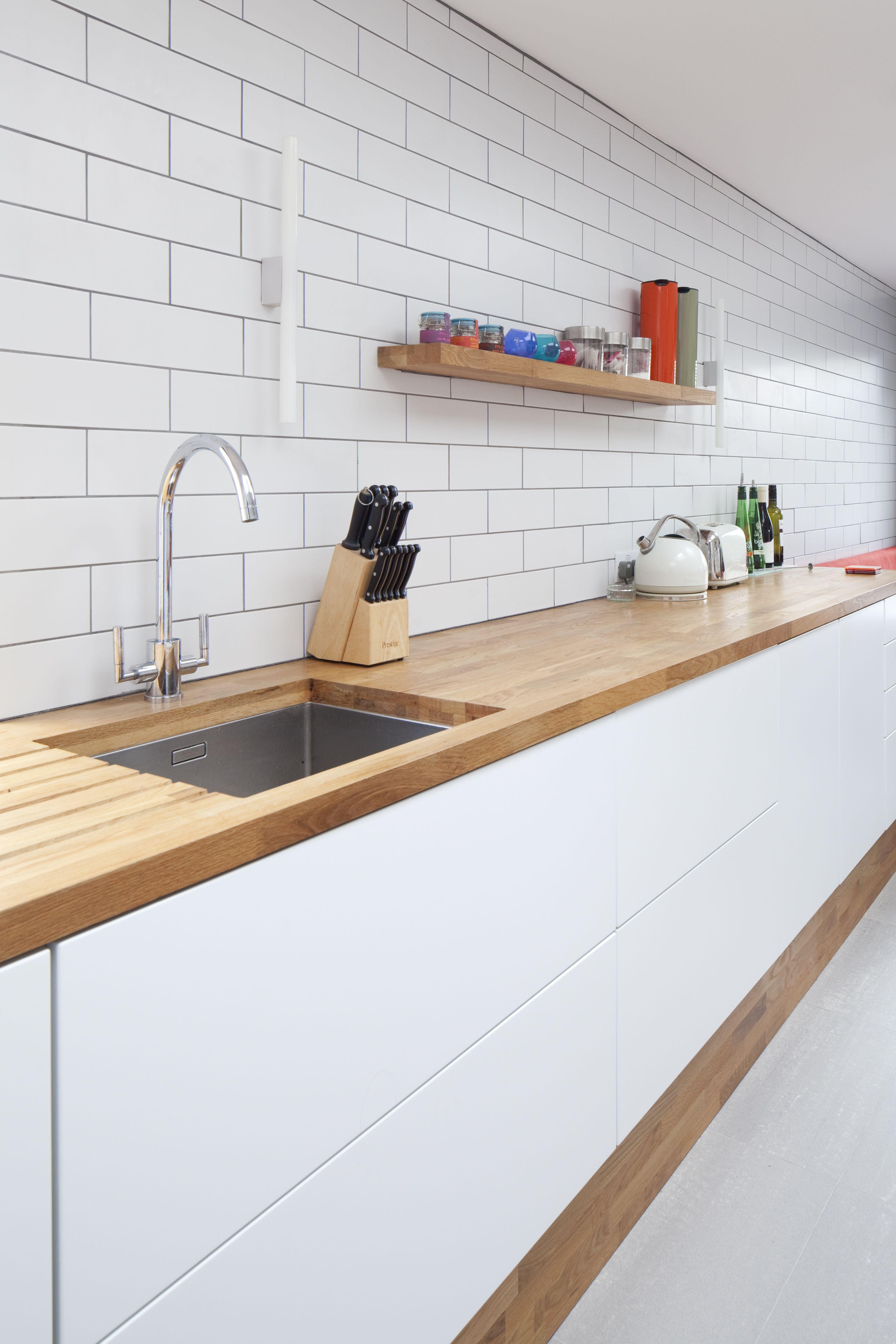 Modern kitchen | timber / wooden worktop | sleek white units | no ...
