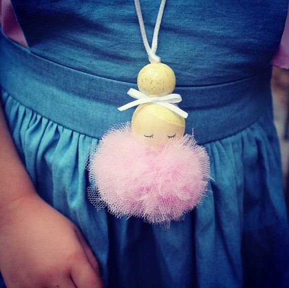 How adorable are these gorgeous girls ? Our ballerinas are now available in a necklace ... they are available in Hair - Blonde Brown Black Pink Purple White Tutu- Pink Purple White Grey Please always keep an eye on your child while wearing this item ..